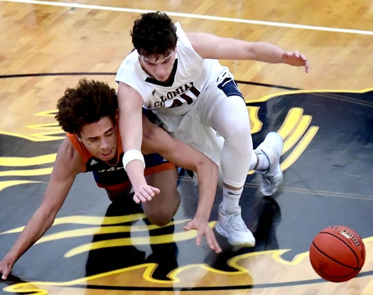 York High's Kevin Glover, left, New Oxford's Connor Jenkins scramble for a loose ball during semifinal action at Red Lion Tuesday, Feb. 11, 2020. Bill Kalina photo