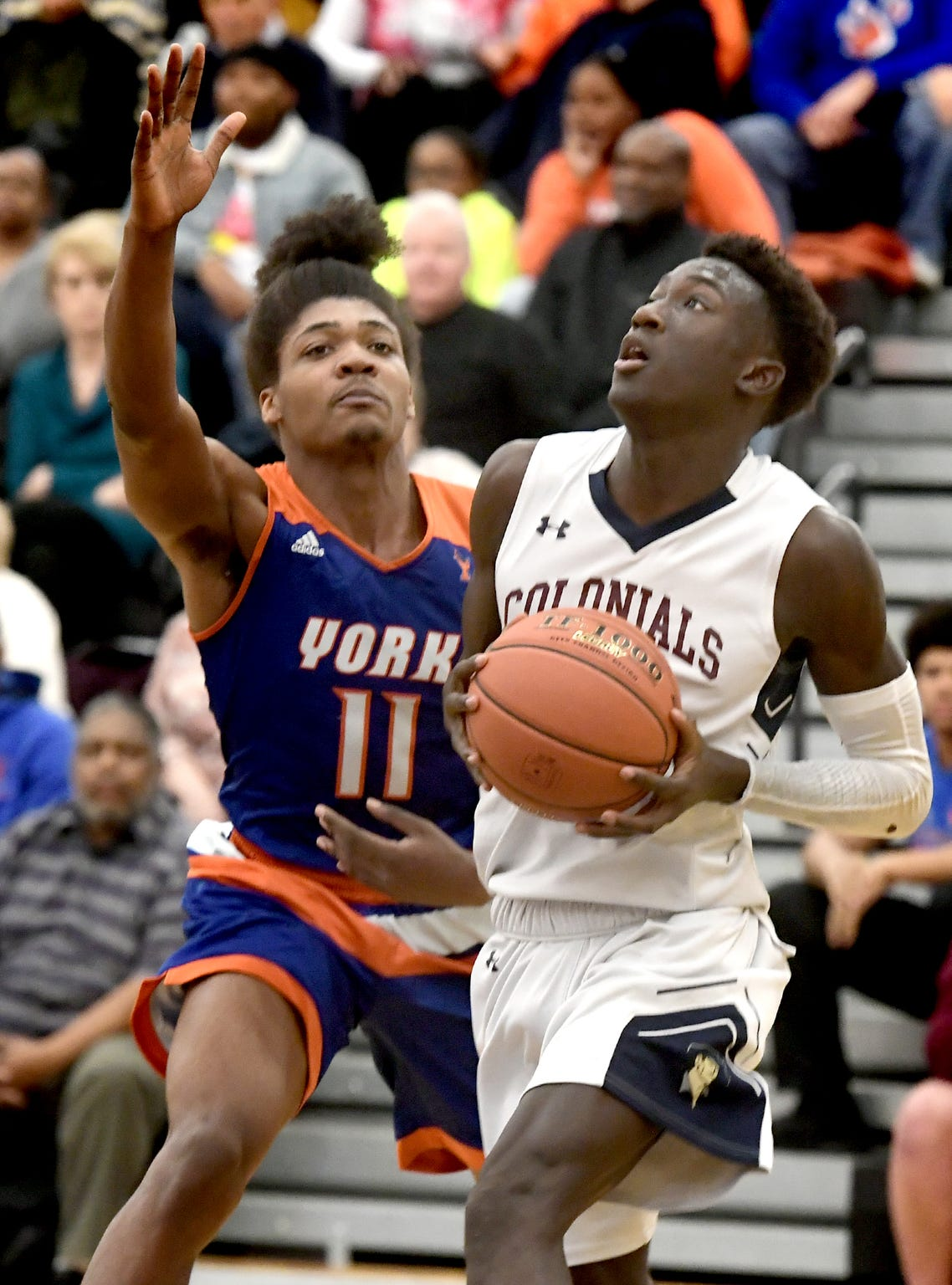 New Oxford's Abdul Janneh gets by York High's Branden Mutunga during semifinal action at Red Lion Tuesday, Feb. 11, 2020. New Oxford went on to win 60-54. Bill Kalina photo