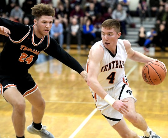 Central York's Gabe Guidinger drives with York Suburban's Aiden Hughley defending during semifinal action at Red Lion Tuesday, Feb. 11, 2020. Central went on to win the game 55-50. Bill Kalina photo