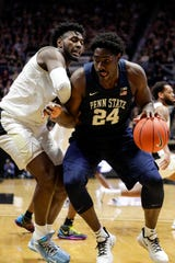 Penn State forward Mike Watkins (24) drives on Purdue forward Trevion Williams (50) during the first half of an NCAA college basketball game in West Lafayette, Ind., Tuesday, Feb. 11, 2020. (AP Photo/Michael Conroy)