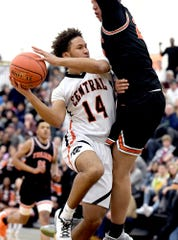 Central York's Kairyn Brown runs into York Suburban's Aiden Hughley during semifinal action at Red Lion Tuesday, Feb. 11, 2020. Bill Kalina photo