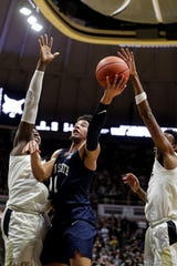 Penn State forward Seth Lundy (1) shoots between Purdue forward Trevion Williams (50) and forward Aaron Wheeler (1) during the first half of an NCAA college basketball game in West Lafayette, Ind., Tuesday, Feb. 11, 2020. (AP Photo/Michael Conroy)