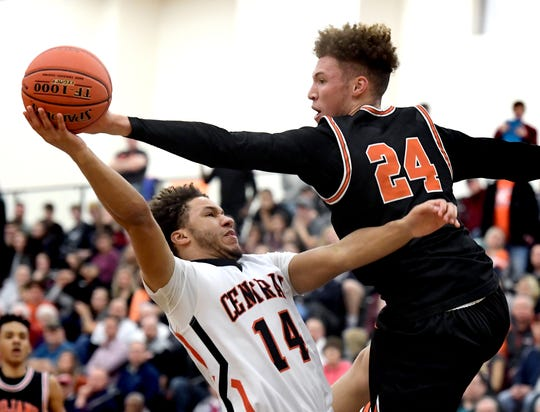 York Suburban's Aidan Hughley, right, defends against Central York's Kairyn Brown during a York-Adams League boys' basketball semifinal on Tuesday night. The Suburban boys' program has been selected as a winner of the the Gretchen Wolf Swartz Sportsmanship Award.