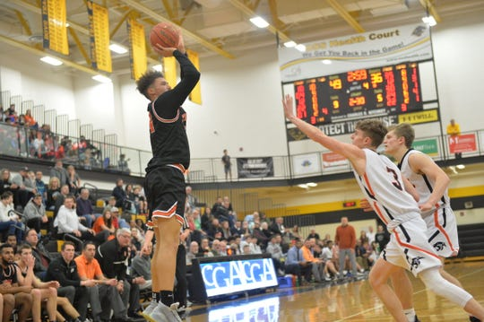 Aidan Hughley (24) takes a jump shot over a Trey Sweigart (3) during a semifinal game on Tuesday, February 11, 2020. Central York defeated York Suburban 55-50.