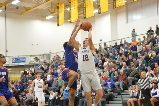 Brayden Long (12) goes up for a lay up during a semifinal game against York High on Tuesday, February 11, 2020. New Oxford defeated York High 60-54.