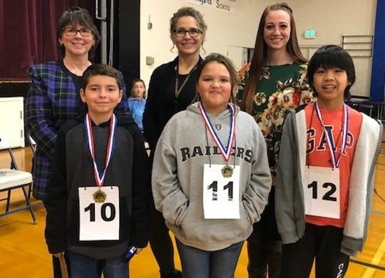 Back row (from left): Official reader Kay Hardesty, judges Jeanette Gillespie and Amanda Angeles. Front row: Fifth-grade winners Connor Kachelmayer, Alleacia Williams and Frank Fiesta.