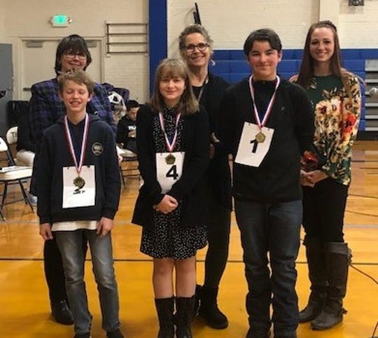 Back row (from left): Official reader Kay Hardesty, judges Jeanette Gillespie and Amanda Angeles. Front row: Seventh-grade winners Jacob Kleine, Tracie Smith and Connor Cueva.