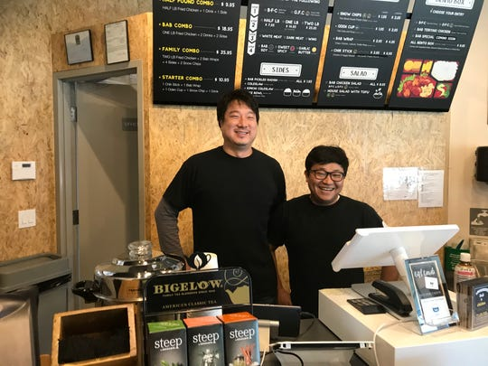 Jay Ryu, left, owner of Bab x Chicken and his chef, J.J. Lee, at the former Bab Café, which re-opened in the Summit Feb. 3 as Bab x Chicken, a Korean fried chicken spot.
