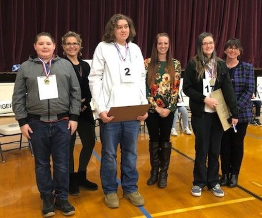 Back row: Official reader Kay Hardesty, judges Jeanette Gillespie and Amanda Angeles. Front row: eighth-grade winners Peyton Panuska, Loring Hutchinson and Haley Chittenden.