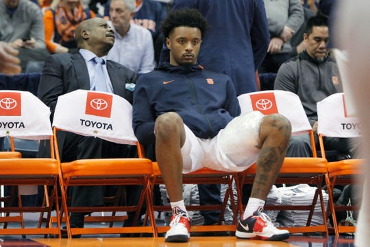 Syracuse's Elijah Hughes sits on the bench with ice on his leg in the second half of an NCAA college basketball game against North Carolina State in Syracuse, N.Y., Tuesday, Feb. 11, 2020. North Carolina State won 79-74. (AP Photo/Nick Lisi)
