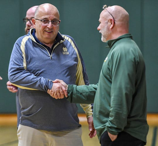 Notre Dame of Batavia head coach Mike Rapone, left, shakes hands with C.G. Finney head coach Joe Marchand after a regular season game at The Charles Finney School on Feb. 11, 2020. Notre Dame Batavia beat C.G. Finney 110-77.