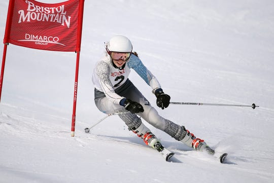 Pittsford's Shannon Hughes navigates around a gate in the Section V girls alpine championship at Bristol Mountain.