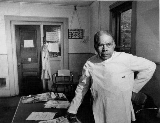 Dr. Charles T. Lunsford, once called 'the Martin Luther King' of Rochester, stands in the waiting room of his office at 572 Clarissa St. He was Rochester's first African American doctor. He served underprivileged communities for more than 50 years.
