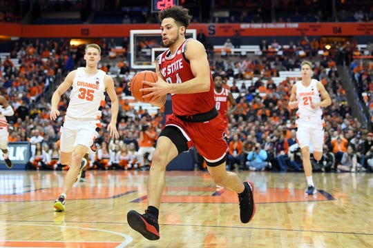 North Carolina State Wolfpack guard Devon Daniels (24) drives to the basket against Syracuse on Tuesday night. Daniels scored 23 points in his team's 79-74 win.