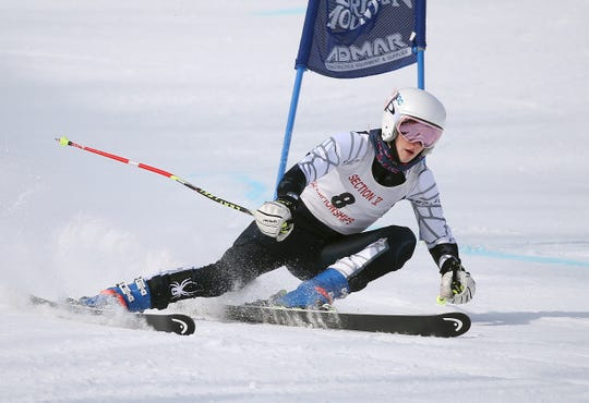 Victor's Taylor Ashe speeds past a gate during the Section V girls alpine championship at Bristol Mountain. Ashe was the slalom champion.