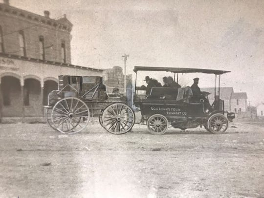 First car in San Angelo: This 1899 photograph shows the St. Louis Motor Co. 2-cylinder automobile, which was the first car in town. According to the original caption, Joe Nussbaumer, who once lived in a rented house on the property that became City Park,  was among the group of local businessmen who used this vehicle.