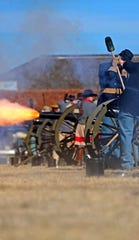 Reenactors fire cannons during the Christmas at Old Fort Concho celebration on Saturday, Dec. 7, 2019.