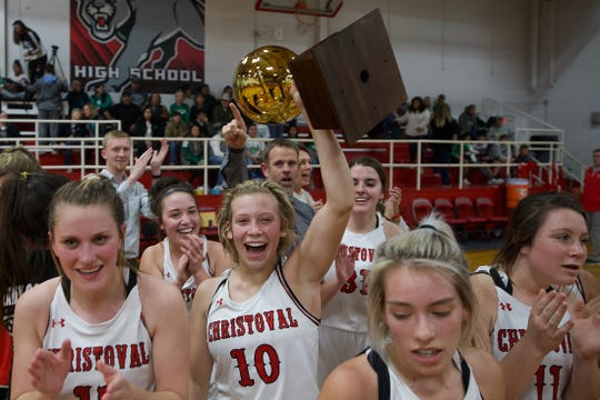 The Christoval girls basketball team celebrates winning the district title Tuesday, Feb. 11, 2020. Allison Vaughn (10) hoists the trophy.