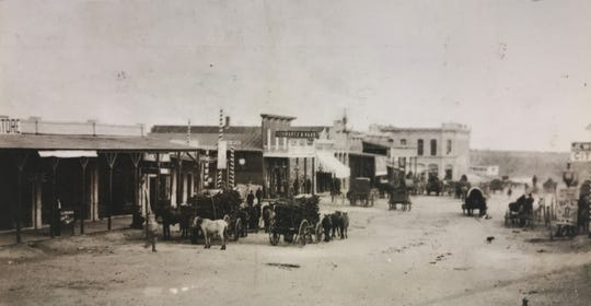 The view looking east down Concho Avenue in San Angelo in 1900.  The Veck-Sterrett Bank can be seen at the end of the street, which was just around the corner from the messy lot that became City Park in 1904.