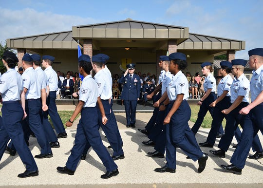 U.S. Air Force Col. Andres Nazario, 17th Training Wing commander, salutes the formation during the pass in review portion of the 17th TRW change of command ceremony at the parade field on Goodfellow Air Force Base, Texas, June 28, 2019. The pass in review is a military tradition meant as a way for a new commander to inspect the troops.