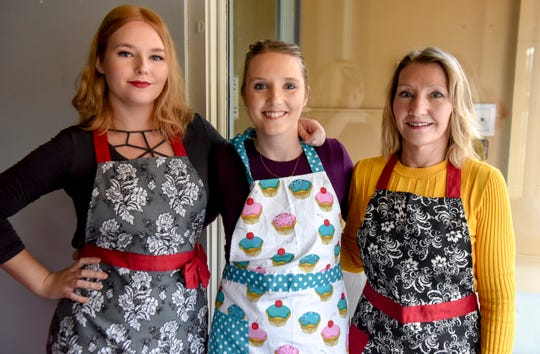 Dana Johnson, Nikki Wallenberg and Val Johnson prepare for the opening of their new bakery Twisted Sisters Sweetz on Wednesday, Feb. 12, 2020 on Phillips Avenue in downtown Sioux Falls, S.D.