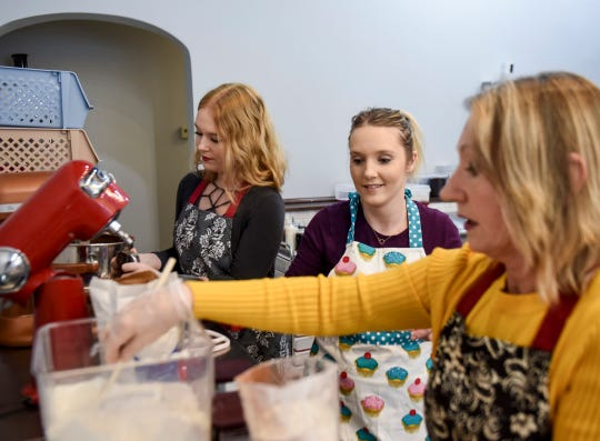Dana Johnson, Nikki Wallenberg and Val Johnson help each other prepare sweets in their new bakery, Twisted Sisters Sweetz, on Wednesday, Feb. 12, 2020 on Phillips Avenue in downtown Sioux Falls, S.D.