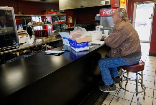 Roy Lauber waits at the counter as Steve Williams, owner of Crosstown Barbecue, prepares his lunch order on Tuesday, Feb. 4, 2020.