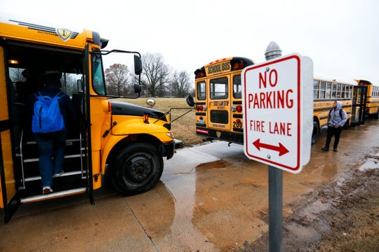 Parkview High School students board a school bus on Wednesday.