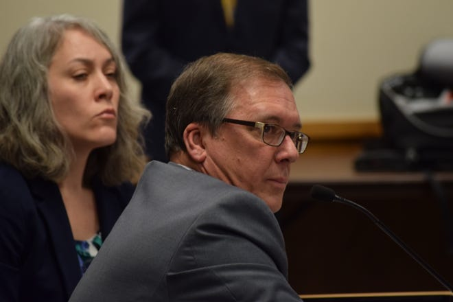 Lyndall Fraker, who runs Missouri's medical marijuana program, testifies before a House government oversight committee Wednesday, Feb. 12, 2020. On his left is program deputy director Amy Moore.