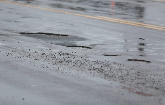 Potholes on South Campbell Avenue on Wednesday, Feb. 12, 2020.