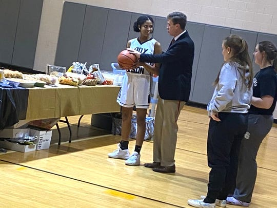 Buffalo Gap's Amaya Lucas and her coach, Phillip Morgan, at a postgame reception Tuesday. Lucas scored her 1,000th career point Tuesday night.