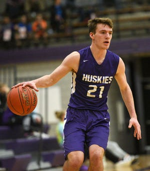 Albany junior Nolan Rueter dribbles the ball against Pierz Tuesday, Feb. 11, 2020, at Albany High School. He'll play for the Comets 17U Elite team this summer.