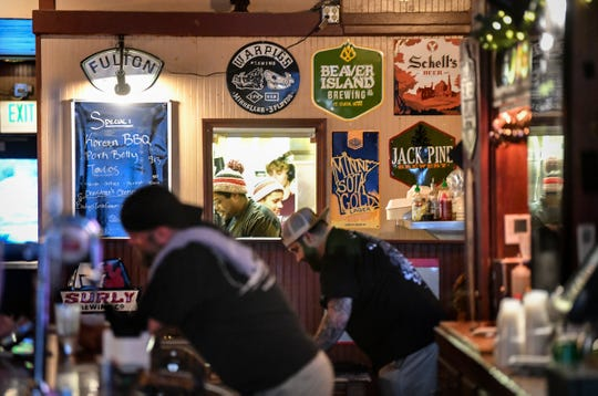 Cooks prepare food from the new menu on its first night Tuesday, Feb. 11, 2020, at the Pickled Loon in St. Cloud.