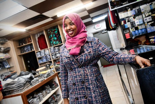 Mako Store owner Fartun Jama smiles while talking about how she decided to open a clothing shop Tuesday, Feb. 11, 2020, at the store in St. Cloud.