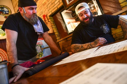 Co-owners Mike Illies and Mike Ahrens talk about the new menu Tuesday, Feb. 11, 2020, at the Pickled Loon in St. Cloud.