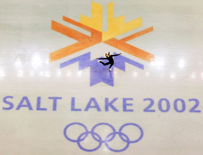 FILE - In this Feb. 8, 2002, file photo, U.S. champion Michelle Kwan practicing for the women's short program for the Winter Olympic Games at the Salt lake Ice Center in Salt Lake City. Salt Lake City may shift its focus to bidding for the 2034 Winter Olympics rather than the games four years earlier following the announcement last month that Sapporo, Japan will bid for 2030, organizing committee members said Wednesday, Feb. 12, 2020. (AP Photo/Doug Mills, File)