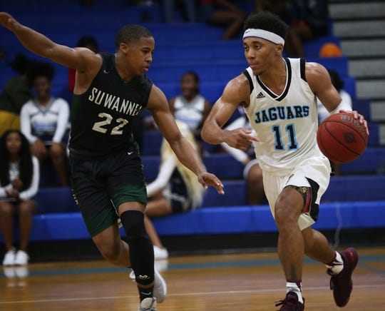 Gadsden County senior guard Jalil Webster dribbles up court as the Jaguars' boys basketball team beat Suwannee 61-52 during a District 2-4A semifinal on Feb. 11, 2020.
