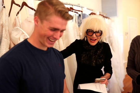 Marsha Doll, founder and owner of Marsha Doll Models, cracks jokes with one of her male models who will be walking the runway during the bridal fashion show at Goodwood Museum an Gardens.