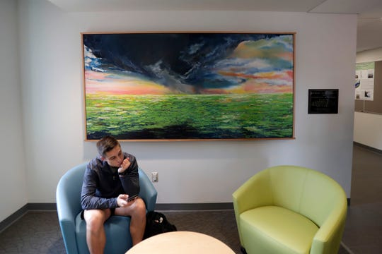 A painting by Gabrielle Lee hangs in an alcove within the new Earth, Ocean, Atmospheric Science Building at Florida State University.