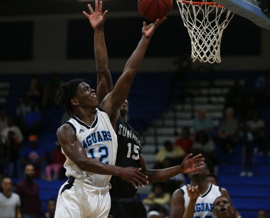 Gadsden County guard James McBride drives for a layup as the Jaguars' boys basketball team beat Suwannee 61-52 during a District 2-4A semifinal on Feb. 11, 2020.