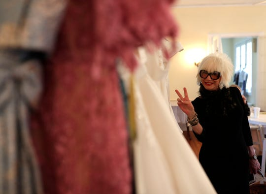 Marsha Doll, founder and owner of Marsha Doll Models, strikes a pose for the camera as she prepares for a bridal fashion show at Goodwood Museum and Gardens.