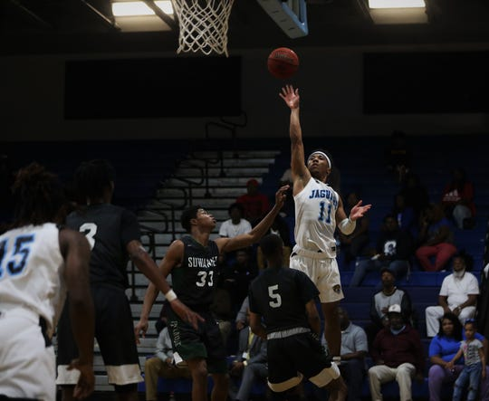 Gadsden County senior guard Jalil Webster tries a floater on the baseline as the Jaguars' boys basketball team beat Suwannee 61-52 during a District 2-4A semifinal on Feb. 11, 2020.