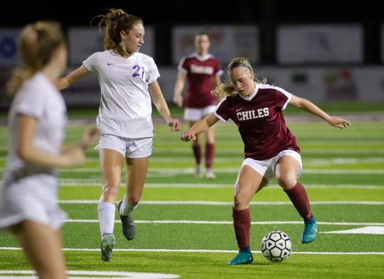 Chiles sophomore Lauren Wilkey dribbles with the ball as Chiles' girls soccer team advanced from a Region 1-6A quarterfinal playoff game following a 5-4 penalty-kick shootout win against Jacksonville Fletcher on Tuesday, Feb. 11, 2020.