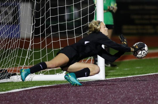 Chiles senior keeper Emily Pollard makes a diving save during a PK shootout as Chiles' girls soccer team advanced from a Region 1-6A quarterfinal playoff game following a 5-4 penalty-kick shootout win against Jacksonville Fletcher on Tuesday, Feb. 11, 2020.