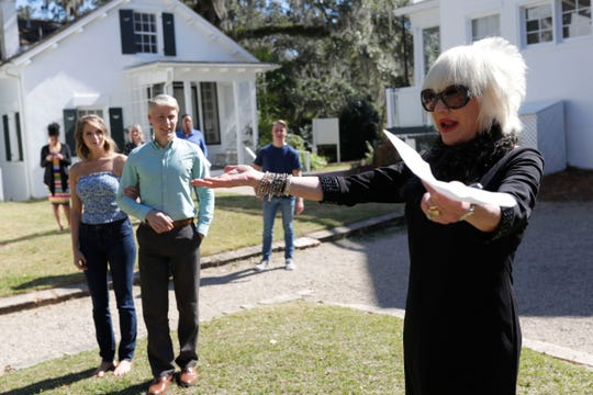 Marsha Doll, founder and owner of Marsha Doll Models, right, directs two models as the do a walkthrough for the bridal fashion show at Goodwood Museum and Gardens.