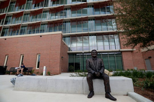 A statue outside the new Earth, Ocean, Atmospheric Science Building honors former FSU President Eric Barron