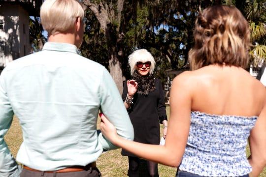 Marsha Doll, founder and owner of Marsha Doll Models, center, gives direction to two of her models who will be walking in the bridal fashion show at Goodwood Museum and Gardens.