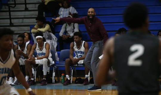 Gadsden County coach Steve Cherry yells out defensive instructions as the Jaguars' boys basketball team beat Suwannee 61-52 during a District 2-4A semifinal on Feb. 11, 2020.