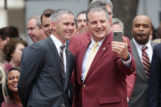 Chief Financial Officer Jimmy Patronis snags a selfie with Florida State University Head Football Coach Mike Norvell during FSU Day at the Capitol Wednesday, Feb. 12, 2020.