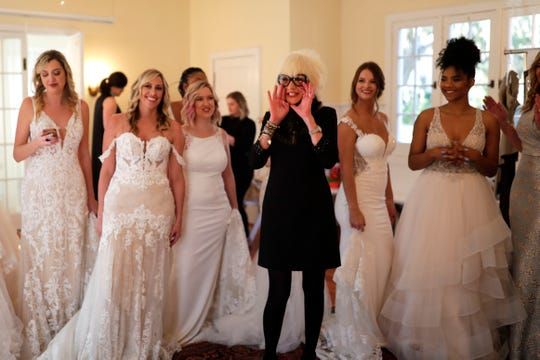 Marsha Doll, founder and owner of Marsha Doll Models,  has her models surround her to record a clip for her Instagram story before a bridal fashion show at Goodwood Museum and Gardens.